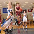 Alex Scharlau, center, Springdale High, finds an open lane to the basket between Rogers High's Zach ...