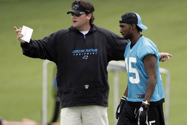Carolina Panthers special teams coordinator Brian Murphy (left), working with receiver Joe Adams (Arkansas) during a preseason minicamp, was fired by Panthers Coach Ron Rivera on Monday after the team gave up a 76-yard punt return for a touchdown to Trindon Holliday in Sunday's 36-14 loss to the Denver Broncos.