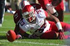 Arkansas' Dennis Johnson loses a fumble in the second quarter of the Razorbacks' loss to South Carolina on Saturday.