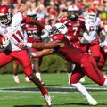 Arkansas Democrat-Gazette/STEPHEN B. THORNTON -- Arkansas' Cobi Hamilton, (11) runs by South Carolin...