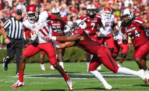 Arkansas Democrat-Gazette/STEPHEN B. THORNTON -- Arkansas' Cobi Hamilton, (11) runs by South Carolina' DeVonte Holloman , right, during the first quarter of their game Saturday afternoon in South Carolina.