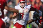 Arkansas Democrat-Gazette/STEPHEN B. THORNTON -- Arkansas QB Tyler Wilson eludes South Carolina defenders in the the third quarter during their game Saturday afternoon in South Carolina.