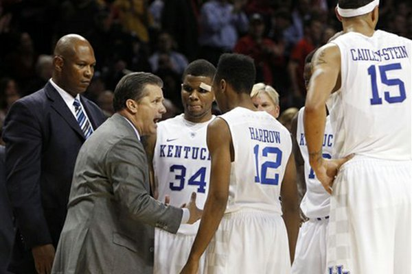Kentucky head coach John Calipari talks to his team during the second half of an NCAA college basketball game against Maryland in the Barclays Center Classic, Friday, Nov. 9, 2012, in New York. Kentucky won 72-69. (AP Photo/Jason Decrow)