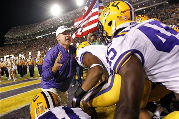 LSU head coach Les Miles leads his team out onto the field before their NCAA college football game against Mississippi State in Baton Rouge, La., Saturday, Nov. 10, 2012. (AP Photo/Gerald Herbert)