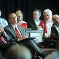 University of Arkansas chancellor G. David Gearhart, from left, athletics director Jeff Long, and fo...