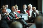 University of Arkansas chancellor G. David Gearhart, from left, athletics director Jeff Long, and former head football coach John L. Smith listen during a Sept. 14, 2012 ceremony for the university's new football center in Fayetteville.