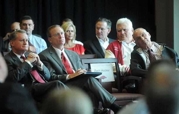university-of-arkansas-chancellor-g-david-gearhart-from-left-athletics-director-jeff-long-and-former-head-football-coach-john-l-smith-listen-during-a-sept-14-2012-ceremony-for-the-universitys-new-football-center-in-fayetteville