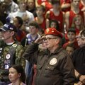 "David Ennis, (above center), ret. U.S. Navy, of Bentonville salutes during the playing of ""Taps"" on ..."