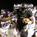 Tearris Wallace, a Bentonville senior running back, breaks through the Fayetteville defense during t...