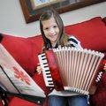 AnnieBeth Mabry, a third-grader at Turnbow Elementary School, holds on Thursday the accordion she is...