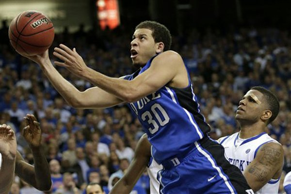 Duke guard Seth Curry (30) shoots over the defense of Kentucky's Julius Mays during the second half of an NCAA college basketball game at the Georgia Dome in Atlanta Tuesday, Nov. 13, 2012. Duke beat Kentucky 75-68. (AP Photo/Dave Martin)