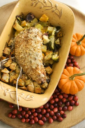 A cozy Thanksgiving dinner for two featuring turkey tenderloin, gravy, roasted vegetables and dressing can be baked in one pan without skimping on traditional fare.