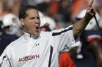 Auburn coach Gene Chizik talks with his team prior to the start of an NCAA college football game between Auburn and New Mexico State at Jordan-Hare Stadium in Auburn, Ala., Saturday, Nov. 3, 2012. (AP Photo/Dave Martin)