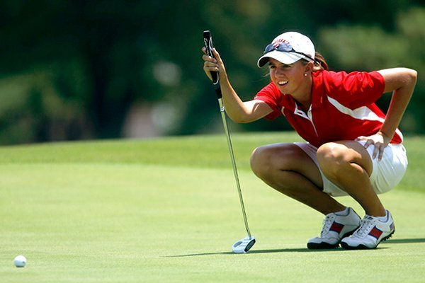 Summar Roachell lines up her putt on the first green at Pinnacle Country Club in Rogers on Monday, June 25, 2012, during the qualifying round for the Wal-Mart NW Arkansas Championship.