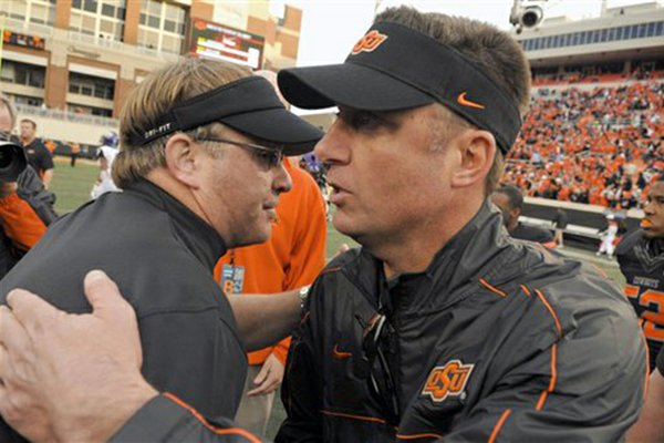 Oklahoma State's Mike Gundy (right) and TCU's Gary Patterson have both been rumored for the Razorbacks' head coaching vacancy.