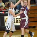 Ashlin Stock, a Siloam Springs junior, tries to drive past Prairie Grove defender Whitnee Fitts duri...