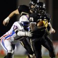 STAFF PHOTO MARC F. HENNING -- Bentonville running back Tearris Wallace, 29, shakes West Memphis def...