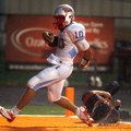 STAFF PHOTO JASON IVESTER -- Fort Smith Southside junior quarterback Issac Jackson scampers into the...