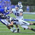 Bryant receiver K.J. Hill (left) is tackled by Conway safety (28) after catching a pass during a Aug...