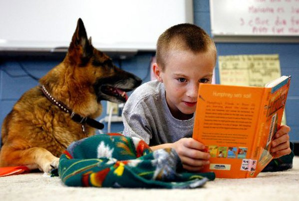 Third-grader Lucas Berens (above) reads ...