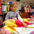 First-graders Matilde Pedro, left, and Presley Evans read Tuesday in their classroom at St. Vincent ...