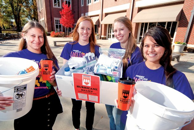 from-the-left-lauren-delano-michaela-fraser-erin-murchison-and-maia-yang-are-raising-money-and-collecting-supplies-for-hurricane-sandy-relief-through-the-volunteer-action-committee-at-hendrix-college-the-relief-effort-breathed-life-after-fraser-related-to-the-group-the-story-of-her-parents-plight-following-sandys-swing-through-long-beach-ny
