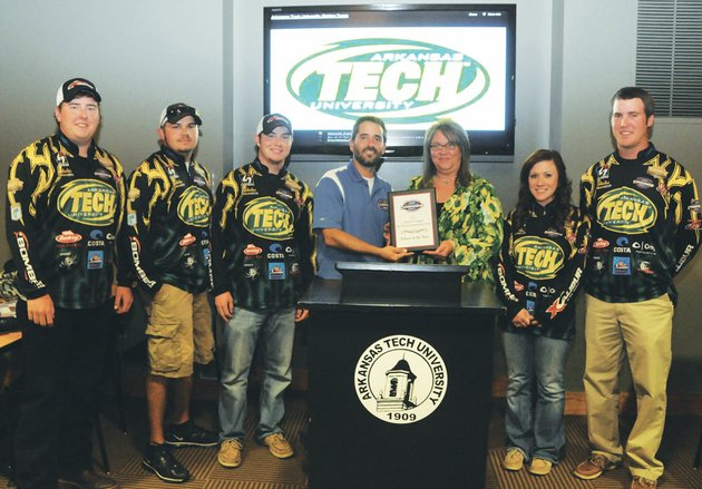 the-arkansas-tech-fishing-club-recently-won-the-inaugural-association-of-collegiate-anglers-school-of-the-year-award-danny-blandford-center-program-director-for-the-associate-of-collegiate-anglers-presented-the-plaque-to-christy-austin-co-sponsor-of-the-club-at-a-banquet-held-at-arkansas-tech-university-others-accepting-the-honor-included-from-the-left-fishing-club-members-clayton-schuh-evan-barnes-aaron-sarna-reagan-moore-and-evan-smith