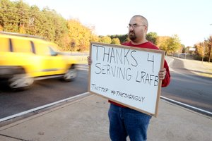 Joe Sachs makes a habit of standing outside the main gate to Little Rock Air Force Base with a sign thanking soldiers for serving the country.