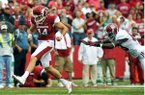 Arkansas punter Dylan Breeding tries to run down an errant first-quarter snap in a 52-0 loss to Alabama in the Razorbacks' conference-opening loss to the Crimson Tide. Alabama took control on the Arkansas 6 after a penalty on Breeding for illegal kicking. Eddie Lacy scored for the Tide on the next play.