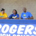 Taylor Strickland, a Rogers High senior, signs to play basketball at Missouri-Kansas City while her ...