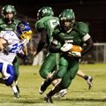 Greenland's Calvin Giddens, center, runs against Mountain View on Oct. 5 at Greenland.