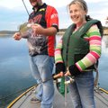 Katelyn Piper and her dad, fishing guide Jason Piper of Rogers, work jigs around timber for crappie ...