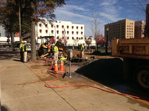 crews-work-thursday-nov-15-2012-to-repair-a-broken-water-main-at-louisiana-and-third-streets-in-downtown-little-rock
