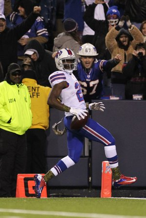 Buffalo Bills cornerback Leodis McKelvin (21) scores on a 79-yard punt return 90 seconds into the first quarter of Thursday's game against the Miami Dolphins in Orchard Park, N.Y. The Bills never trailed and won 19-14.