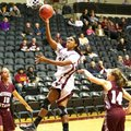 UALR forward Janette Merriex goes up for a shot between two Missouri State defenders during the firs...