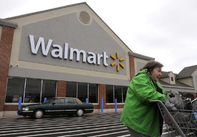 a-woman-exits-a-wal-mart-store-in-north-kingstown-ri-on-tuesday-wal-mart-stores-inc-on-thursday-reported-a-profit-of-364-billion