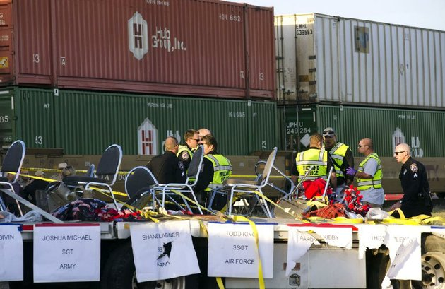 police-fire-and-sheriffs-personnel-respond-to-an-accident-in-which-a-flatbed-trailer-carrying-wounded-veterans-in-a-parade-was-struck-by-a-train-at-a-crossing-thursday-in-midland-texas