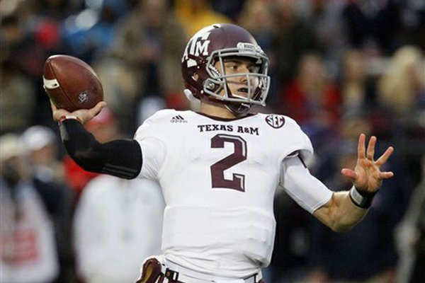 Texas A&M quarterback Johnny Manziel won the Heisman Trophy, outscoring runner-up Manti Teo by more than 300 Heisman voting points. (AP Photo/Rogelio V. Solis)