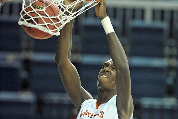 Bobby Portis will sign with Arkansas on Friday.
