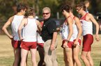 Arkansas Coach Chris Bucknam (center) and the Razorbacks are ranked 11th nationally heading into Saturday's race.