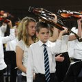 Michael Weir, 11, leads fellow sixth-graders in a demonstration of the process to achieve a proper p...