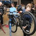 Martin Johnson, right, mechanic with Phat Tire, checks the brakes and gear alignment of a bicycle We...