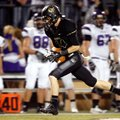 Trey Perkins, Bentonville senior wide receiver, pulls in a long reception for a touchdown Nov. 2 aga...