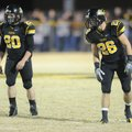 Weston, left, and Logan Bartholomew, cousins playing for Prairie Grove, line up next to each other N...