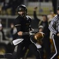 STAFF PHOTO MARC F. HENNING -- Bentonville defensive back Austin Haggard scores a touchdown after st...