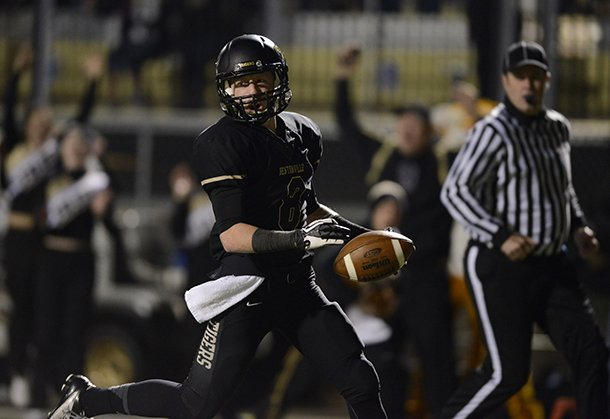 staff-photo-marc-f-henning-bentonville-defensive-back-austin-haggard-scores-a-touchdown-after-stripping-the-ball-away-from-west-memphis-on-friday-nov-16-2012-during-the-first-quarter-of-the-tigers-class-7a-playoff-game-against-the-blue-devils-at-tiger-stadium-in-bentonville