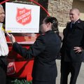 Vernon Fernandez, from left, Harps store manager, chats Thursday with Salvation Army Maj. Denise Wil...
