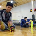 Javier Rubio, (above) 12, a student at Helen Tyson Middle School, quickly unstacks cups Thursday dur...