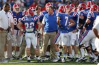 In this Nov. 3, 2012 photo, Louisiana Tech head football coach Sonny Dykes talks with his team during an NCAA college football game against Texas-San Antonio at Joe Aillet Stadium in Ruston, La. (AP Photo/The El Dorado News-Times, Michael Orrell)