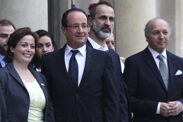 french-president-francois-hollande-second-from-left-head-of-the-new-syrian-national-coalition-for-opposition-and-revolutionary-forces-mouaz-al-khatib-second-from-right-syrian-opposition-member-suheir-atassi-left-and-french-foreign-minister-laurent-fabius-right-pose-for-photos-prior-to-a-meeting-at-the-elysee-palace-in-paris-saturday-nov-17-2012-france-has-taken-a-leading-role-among-western-countries-in-supporting-syrias-rebels-on-tuesday-it-became-the-first-western-nation-to-formally-recognize-syrias-newly-formed-opposition-coalition-as-the-sole-legitimate-representative-of-the-syrian-people